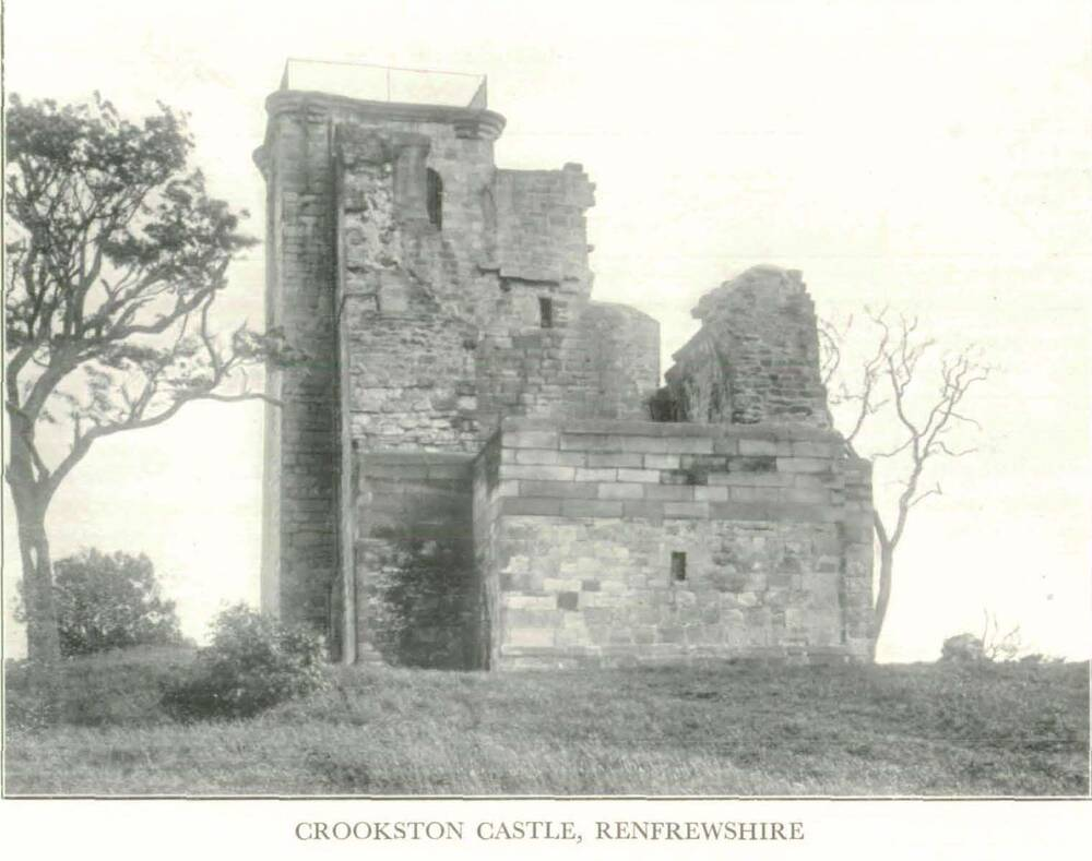 A sepia photograph of a ruined Crookston Castle, with bare trees growing either side.