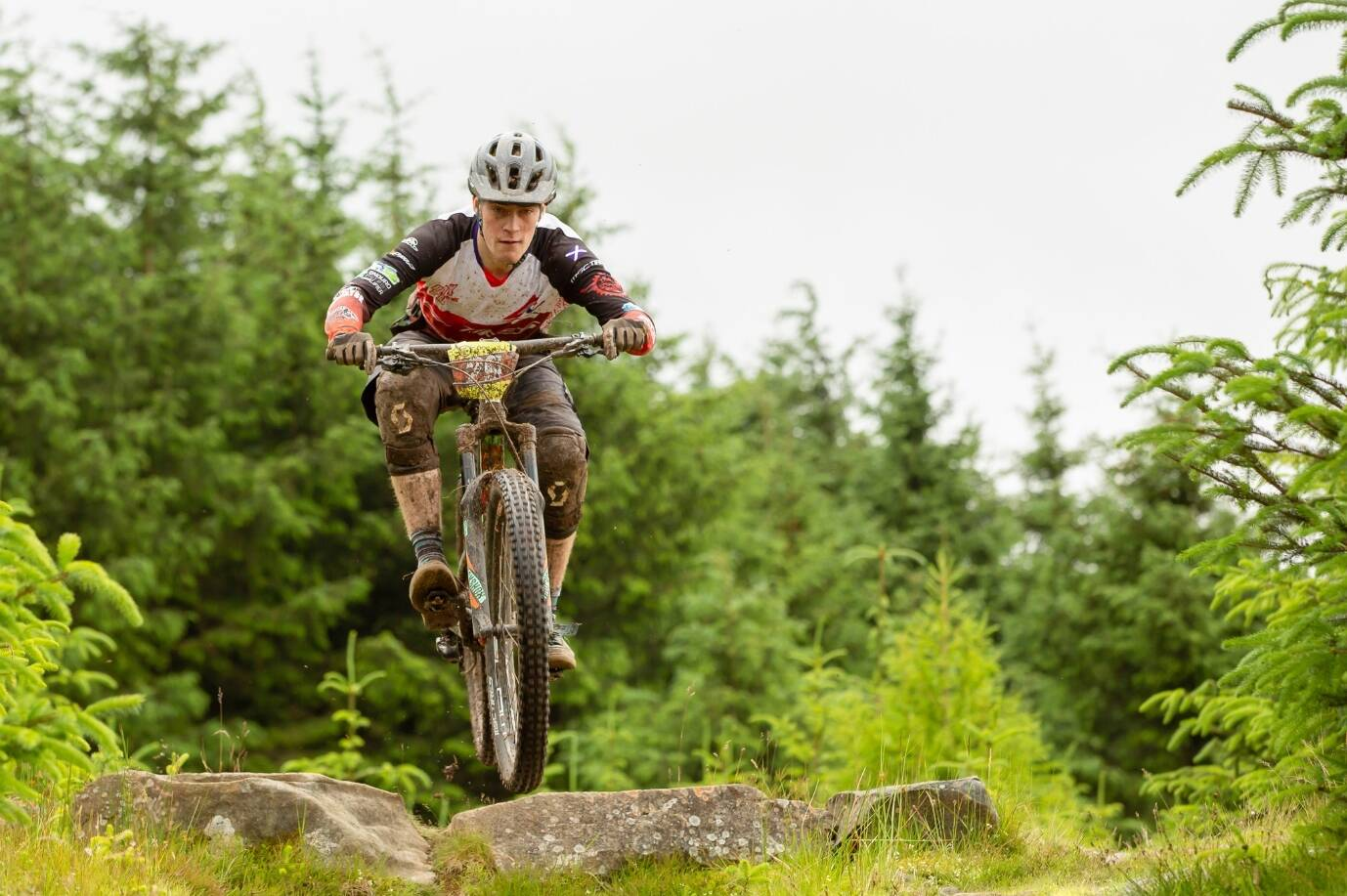 Douglas Carchrie, winner of the Dick Balharry Prize in 2018. He is pictured doing a jump in a wooded area on a mountain bike.