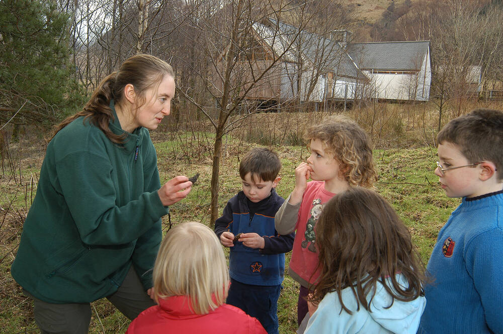 Children learning about nature from one of the Glencoe ranger team