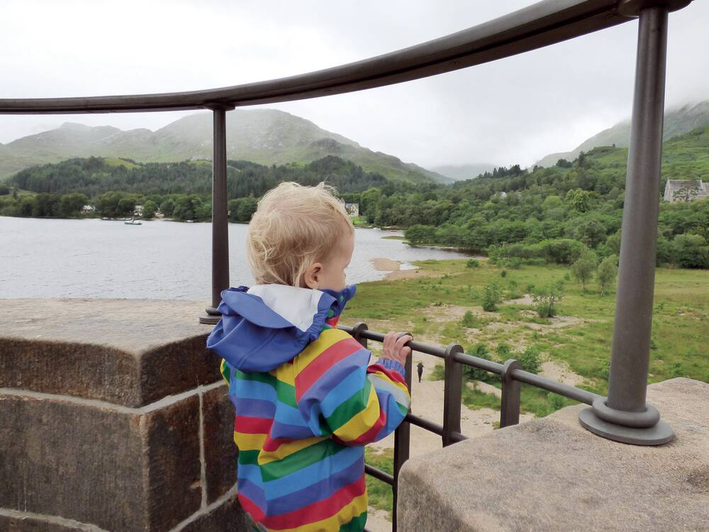 Child looking out at the view from Glenfinnan Monument