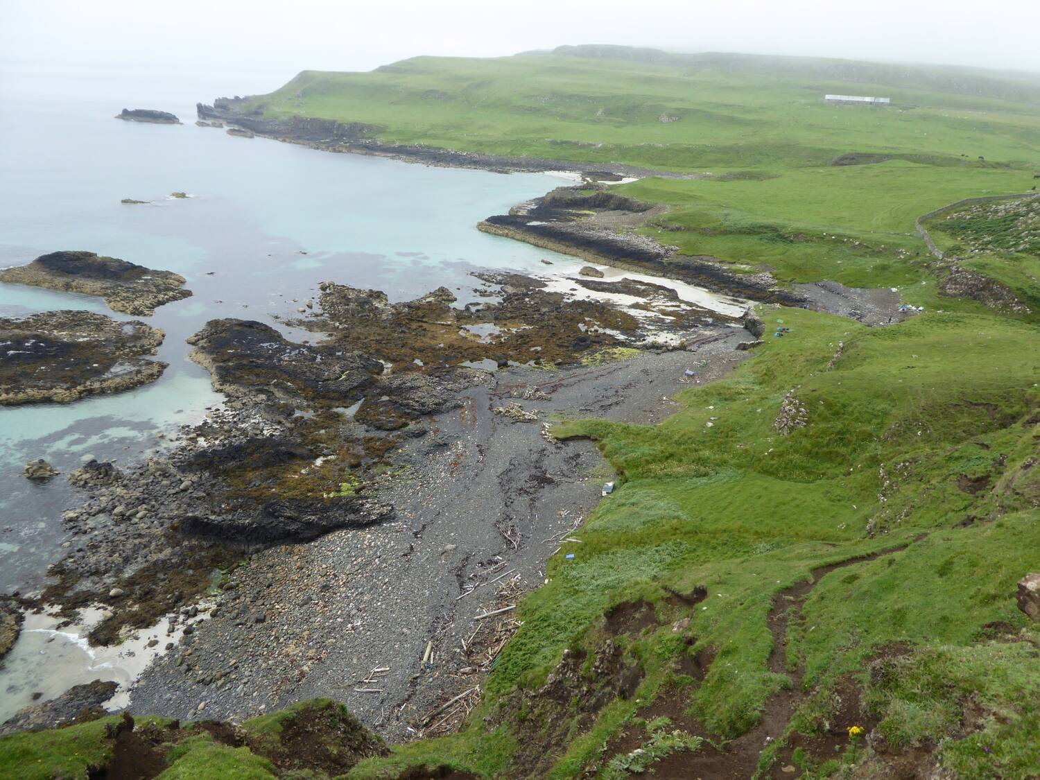 An aerial view of a section of coastline on Canna