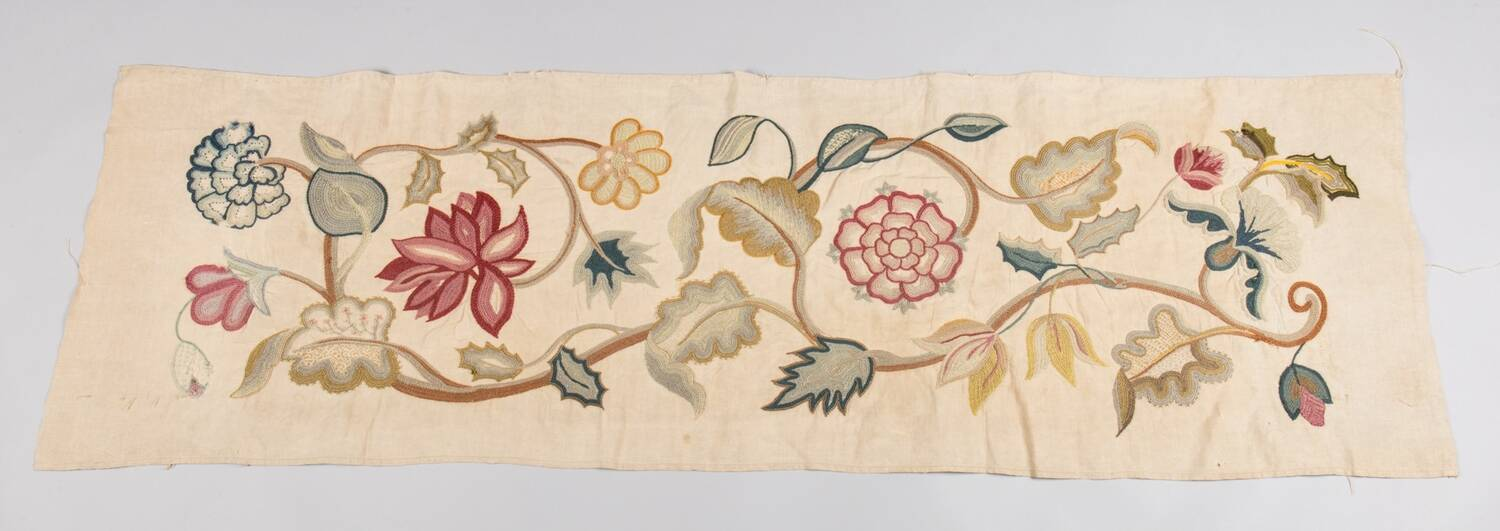 An embroidered panel shows a floral design, found at Crathes Castle.