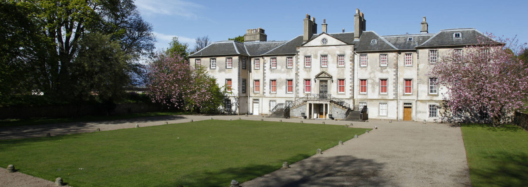 Newhailes House, seen from the end of the driveway on a sunny day