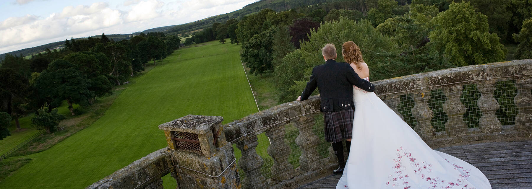 Wedding couple on the roof balcony at Castle Fraser