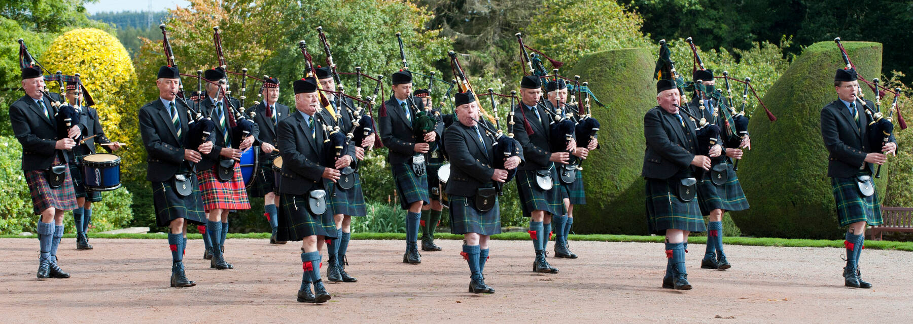 Pipe band playing and walking up the driveway at Crathes Castle