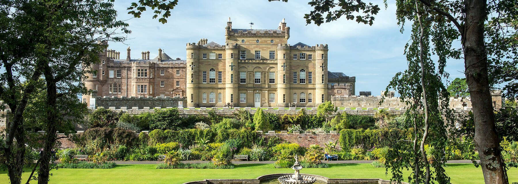 Culzean Castle in the summer, with the Fountain Court in front.