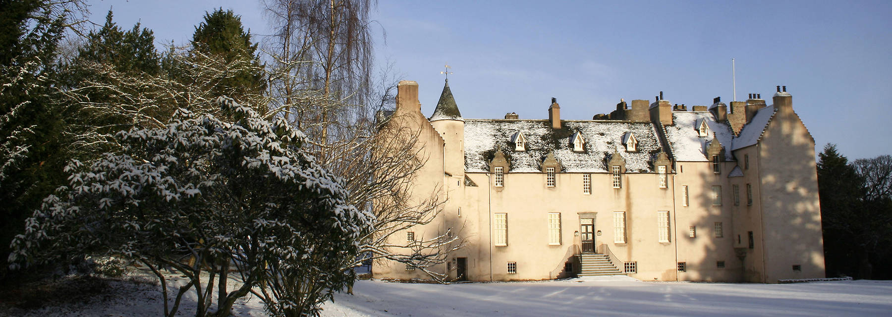 Exterior of Drum Castle in the snow