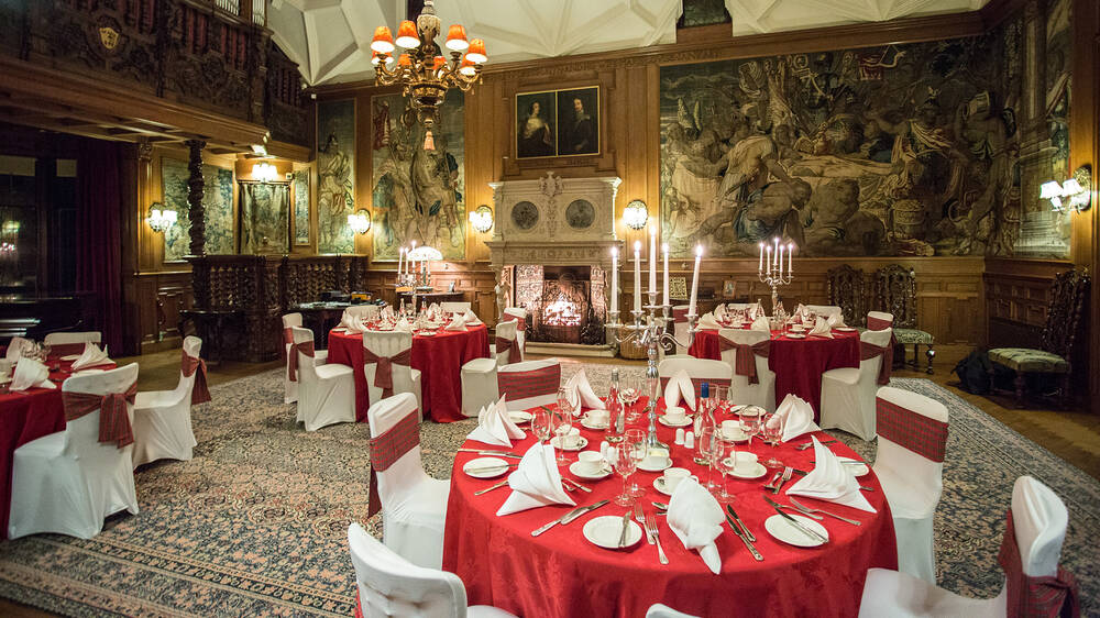 Interior of Fyvie Castle with tables laid for an occasion