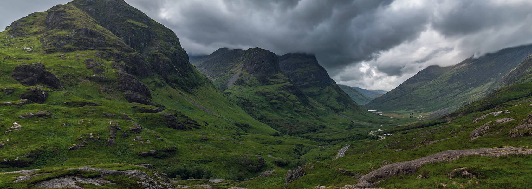 Glencoe, the mountains and main road winding through the glen.