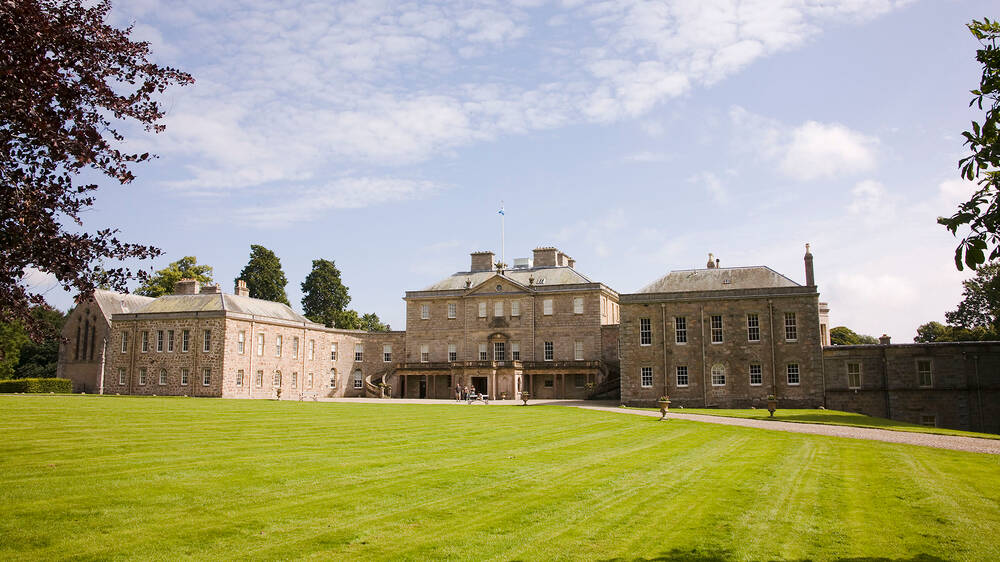 Haddo House seen from the far side of the immaculate and vast front lawn.