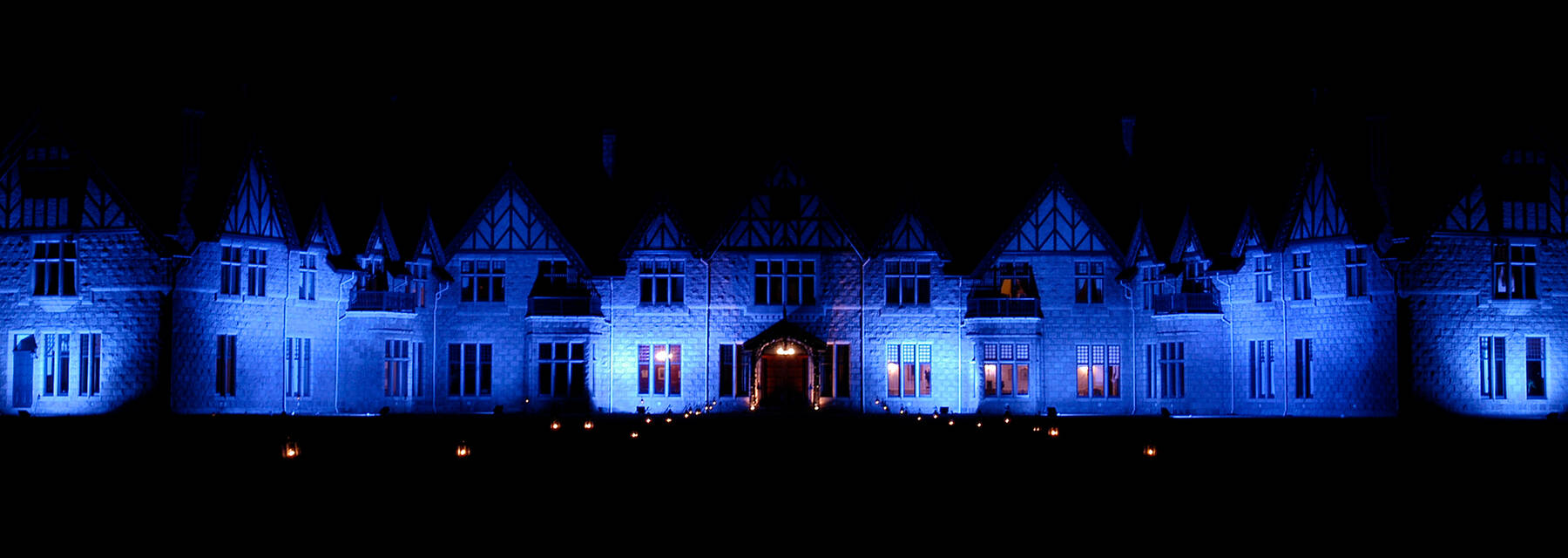 Mar Lodge lit up at night with blue lights
