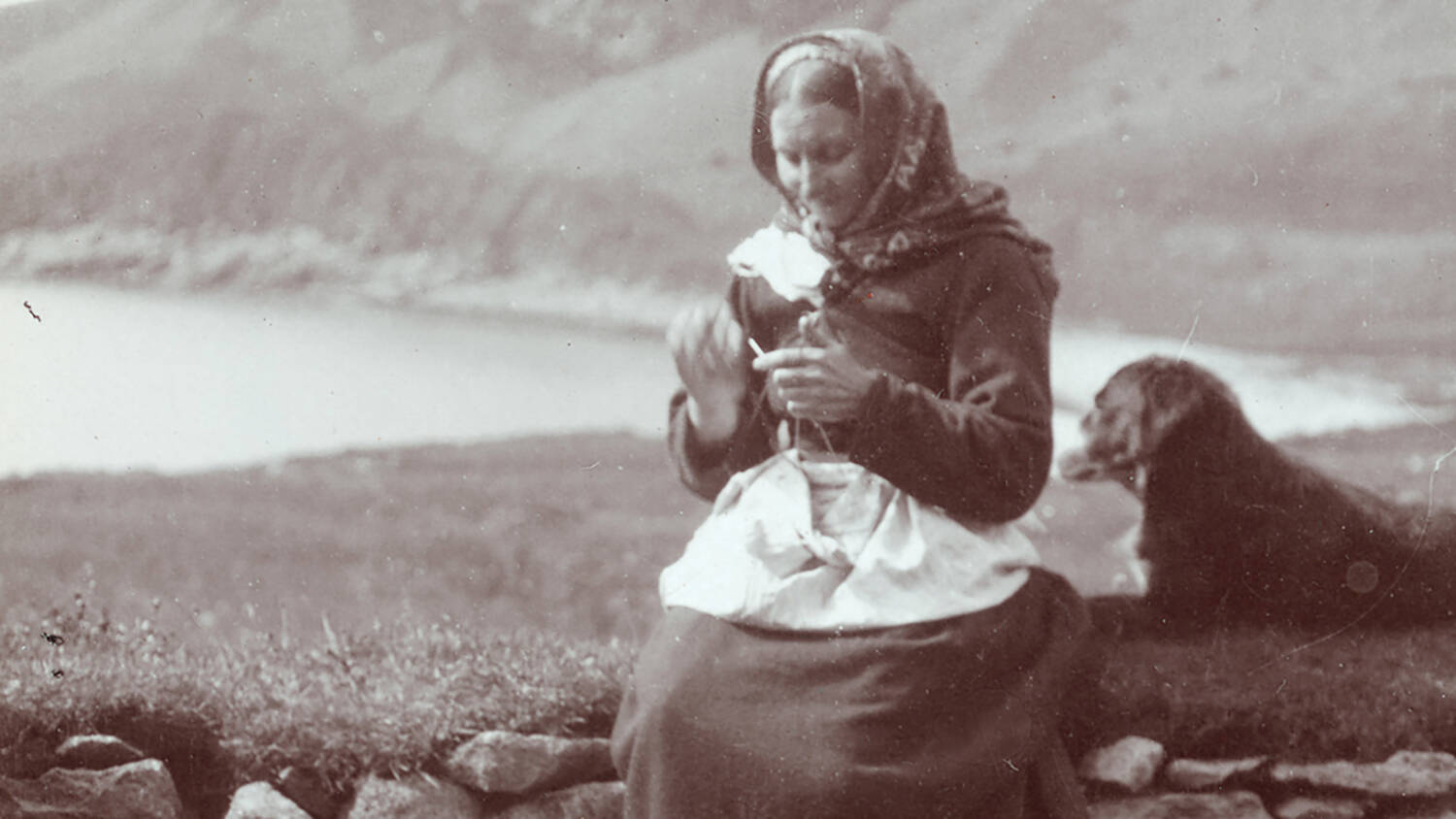 A black and white photo of a St Kilda women knitting
