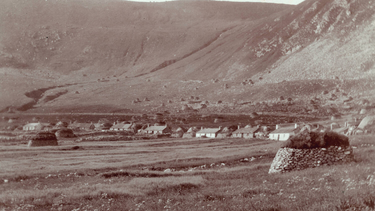 A black and white photo of the village on Hirta.