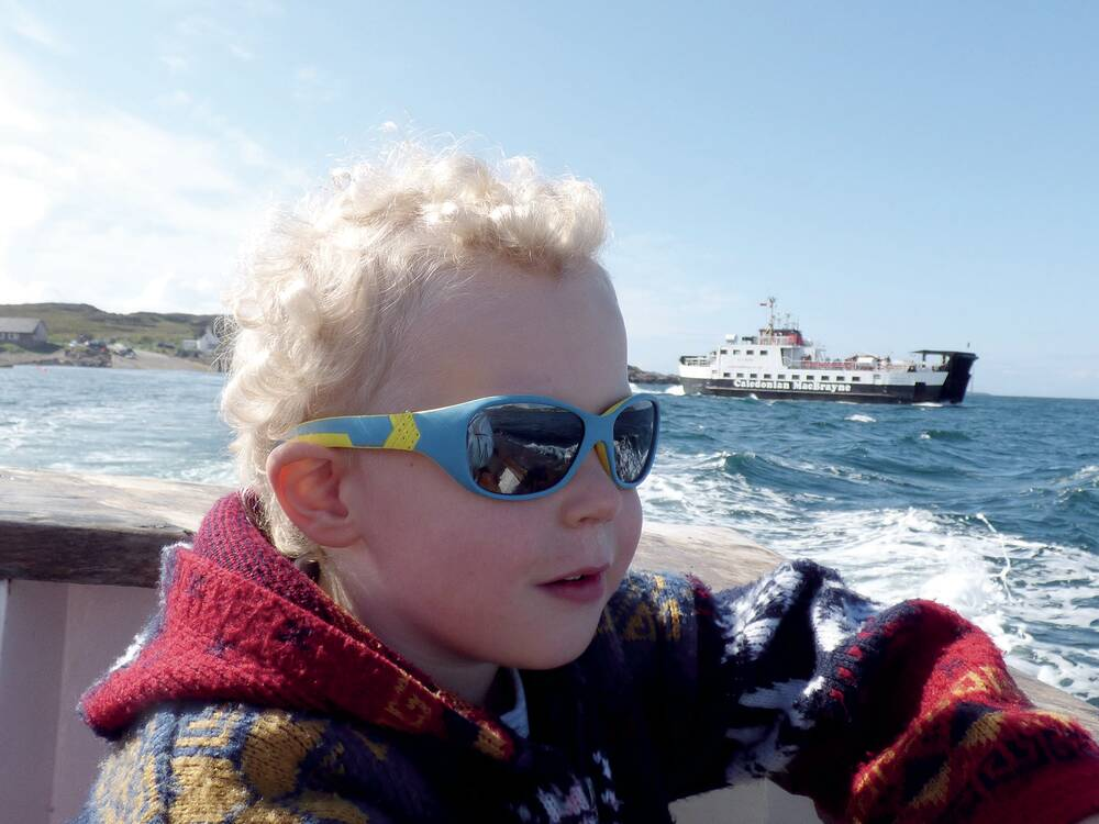 Child on boat heading to Staffa