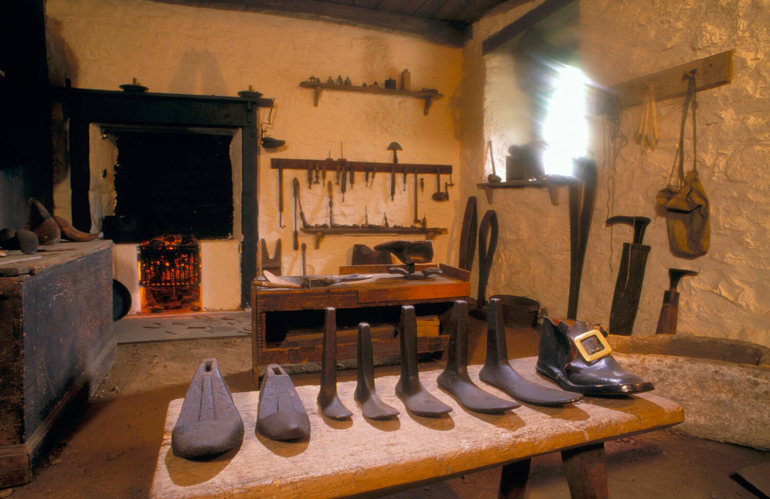 Souter Johnnie's workshop with a fireplace and all the shoemaking tools