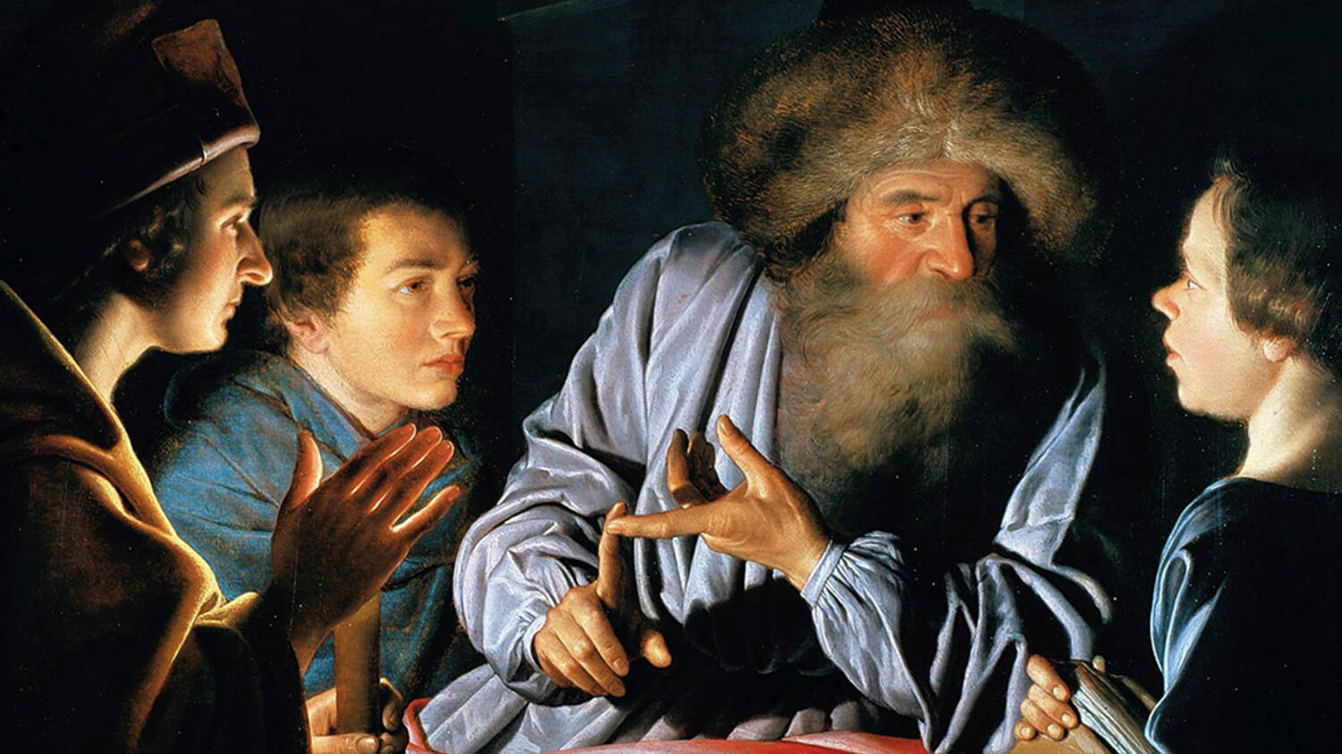 A close-up of an old painting, showing an older bearded man sitting at a table with younger boy pupils sitting around him. They are listening as he talks.