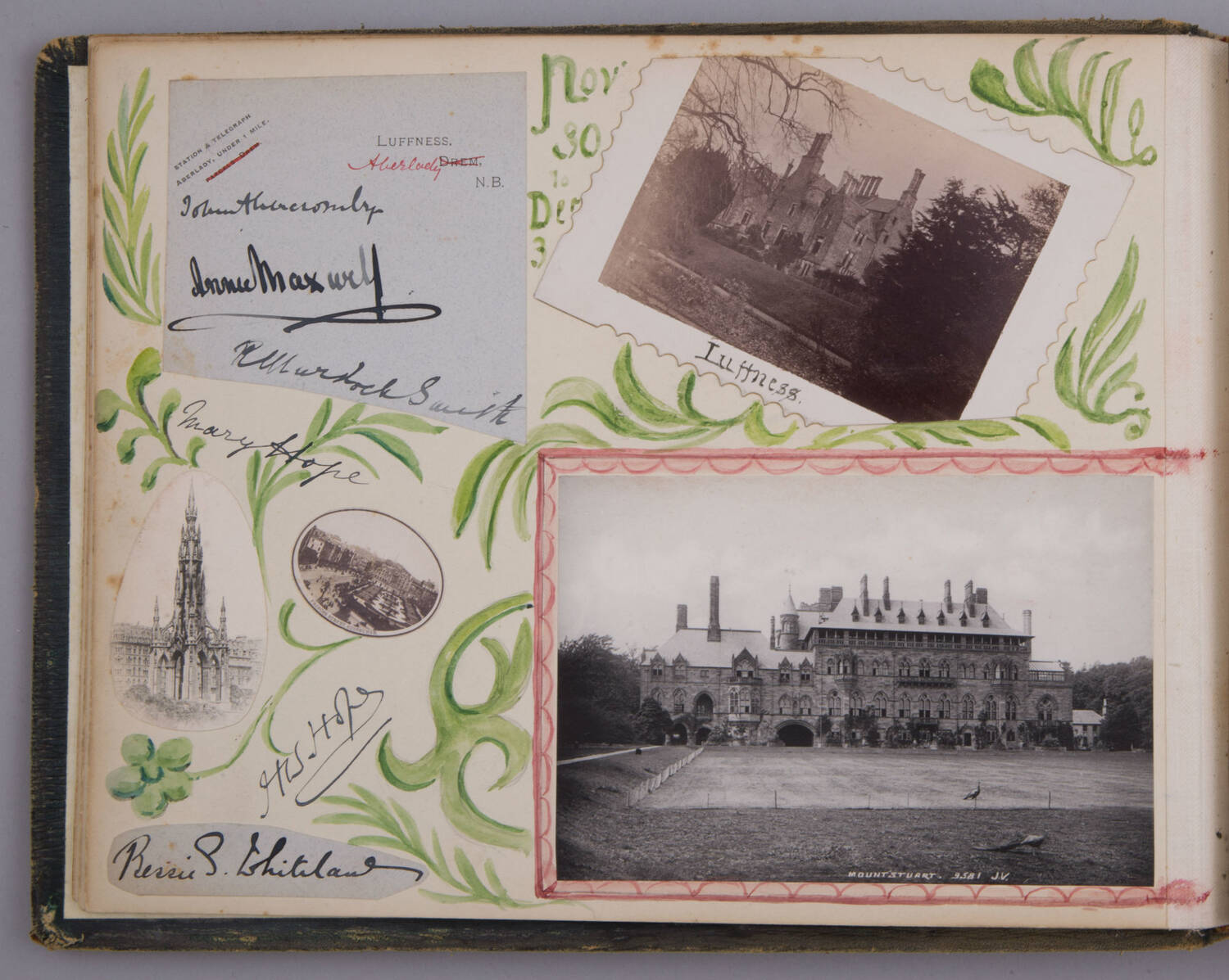 A single page in a scrapbook album. In the bottom left corner of the page are two oval photographs, showing the Walter Scott Monument and Princes Street Garden, Edinburgh. Above this is piece of pale blue notepaper. This has 'LUFFNESS, Aberlady, NB' printed on it in black ink, and three handwritten signatures. In the top right corner of the page is a black and white photograph of Luffness House. Beneath this is a black and white photograph of Mount Stuart, a large stately home on the Isle of Bute. Vines have been painted across the page in green watercolour.