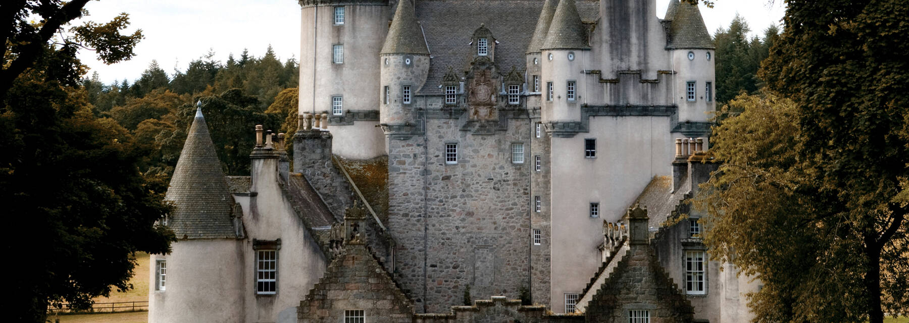 View of Castle Fraser's main entrance in autumn