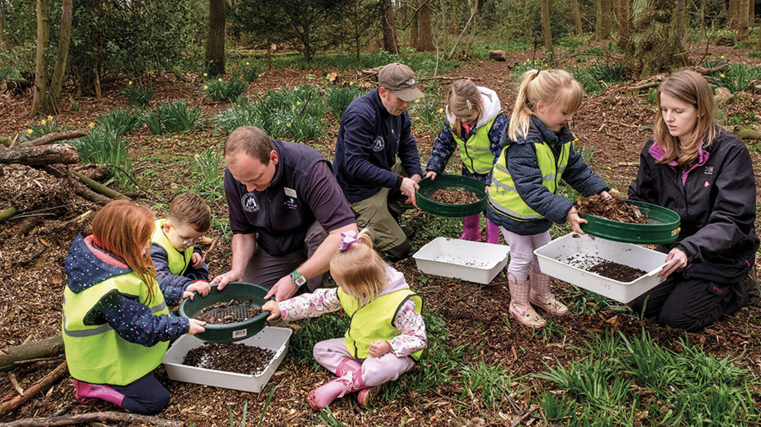 Children learning outdoors with our rangers