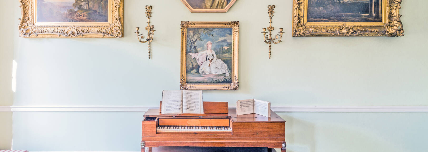 The drawing room with square piano and paintings