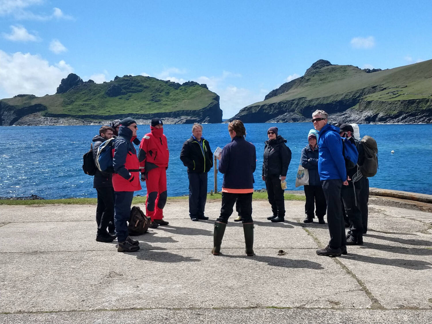 A group of people standing on the jetty on Hirta, St Kilda