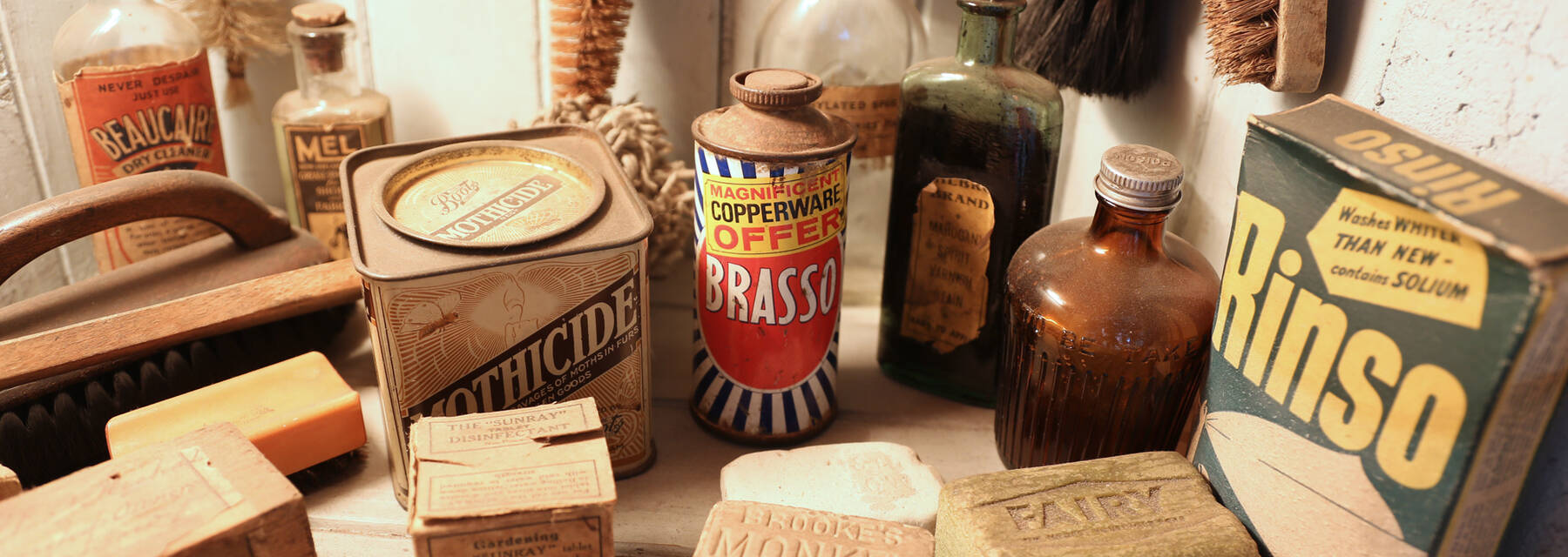 Household cleaning products on a shelf in the Tenement House kitchen