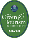 The Green Tourism Business Scheme badge for a silver award. The text is displayed in a green oval with a picture of a thistle at the top.