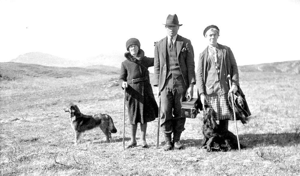 Sisters Peggy and Mairi Macrae, Margaret's landladies, with Finlay Mackenzie of the Lochboisdale Hotel, c 1934. Finlay carries Margaret's Graflex camera.
