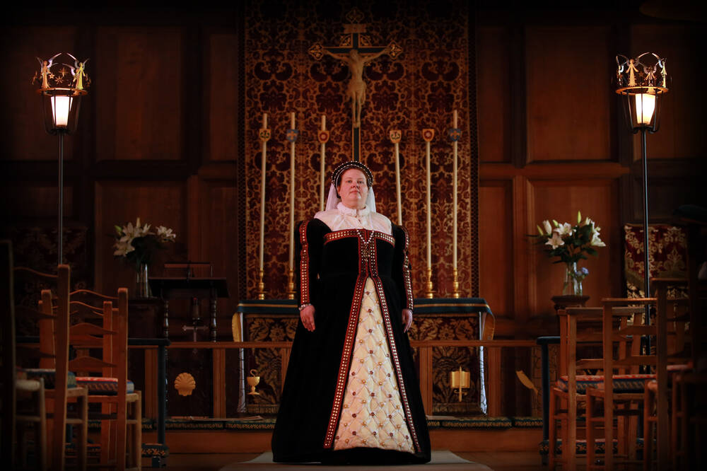 A volunteer dressed as Mary, Queen of Scots stands in front of the altar in Falkland Palace.