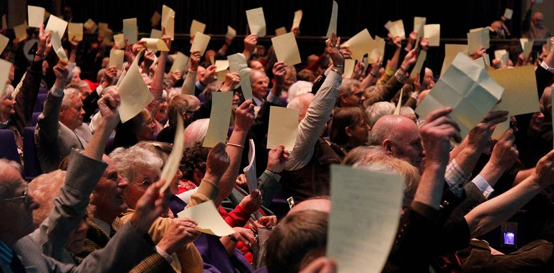 Members voting at the Annual General Meeting