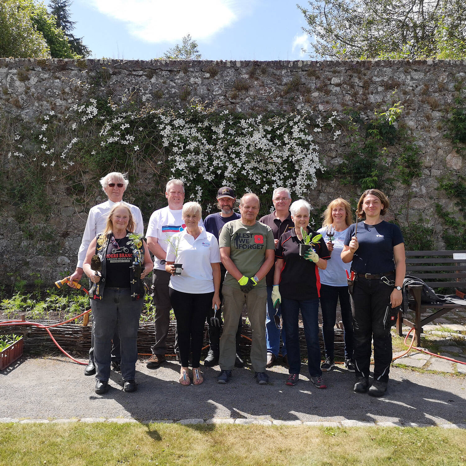 Members of the Royal British Legion helped plant white borders at Trust gardens