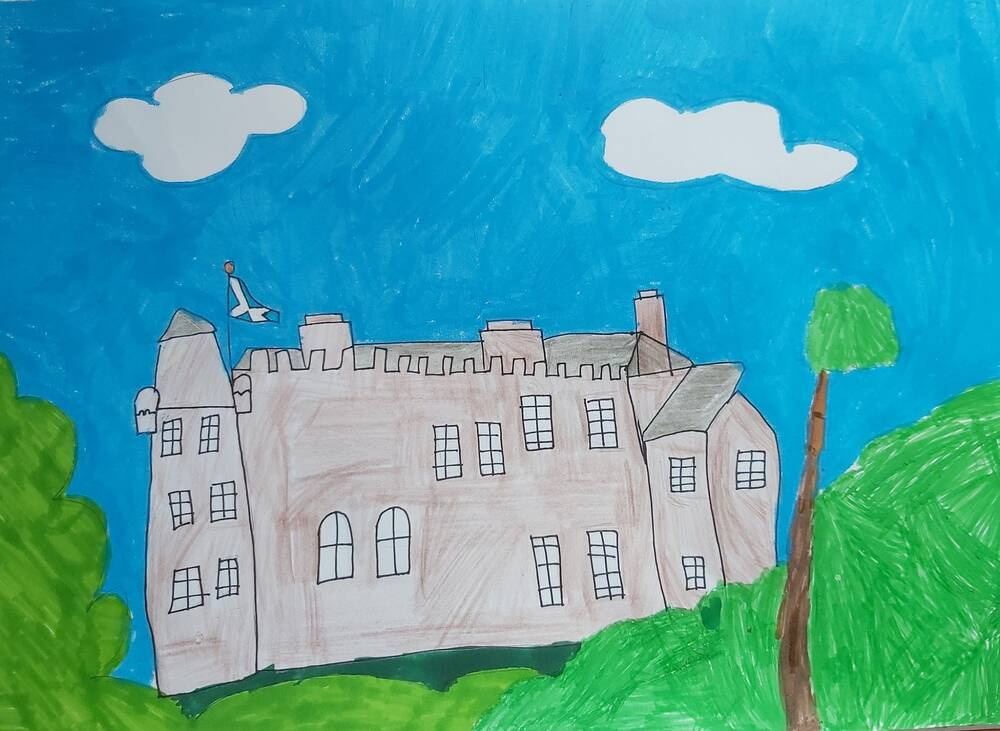 A felt pen picture of a castle on top of a small hill, against a bright blue sky with a couple of white fluffy clouds. A tall tree stands in the foregound. A Scottish saltire flies from the roof.