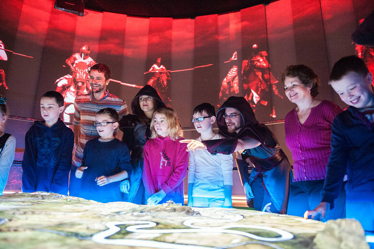 Children stand around an interactive map of Bannockburn