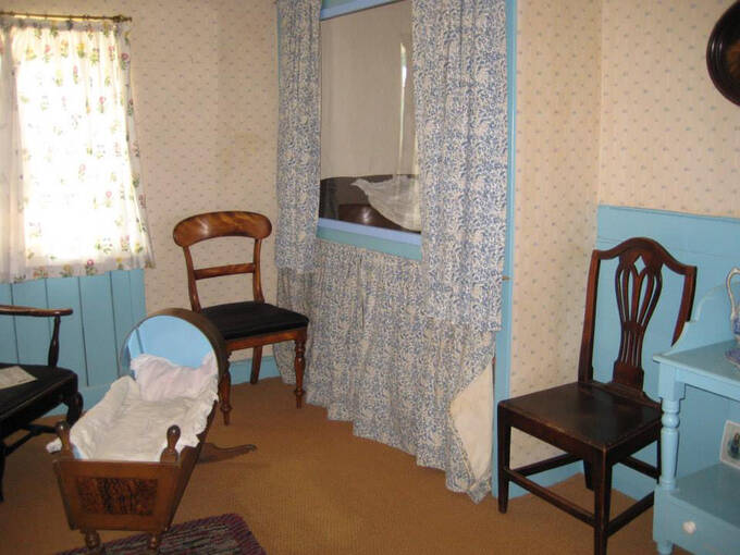 Period furniture stands in the bedroom at J M Barrie's Birthplace