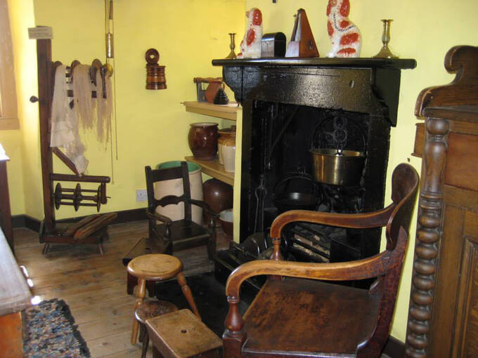 Period appliances and furniture in the family kitchen at J M Barrie's Birthplace