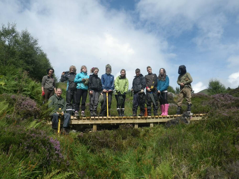 The Ben Lawers Trailblazers standing on the replacement boardwalk that they built