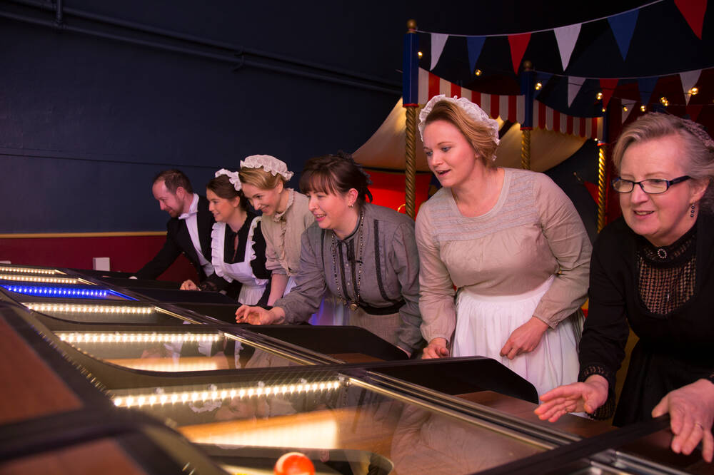 Staff at Brodick Castle playing games in the new Victorian Arcade