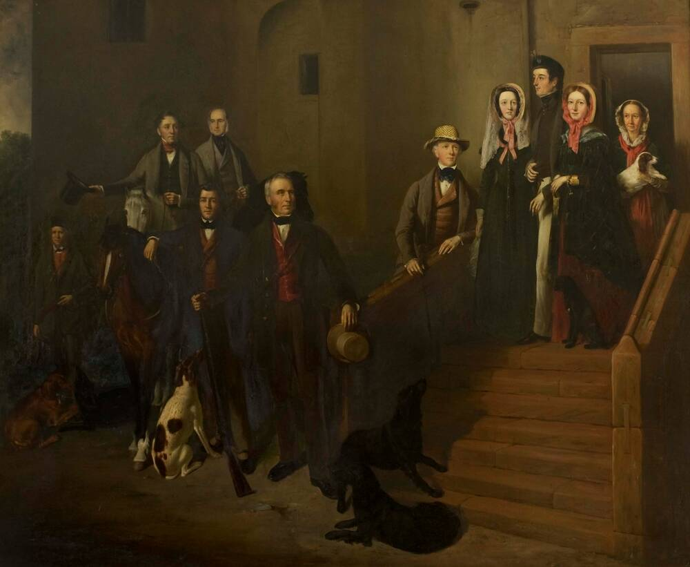 An oil painting of a group of smartly dressed people gathered around some steps that lead up to a narrow door in a castle. On the top step stands a young man, with his arms linked to a young woman either side. Behind them stands an older woman, holding a dog in her arms. At the foot of the steps are a number of men, two horses and several frolicking dogs.