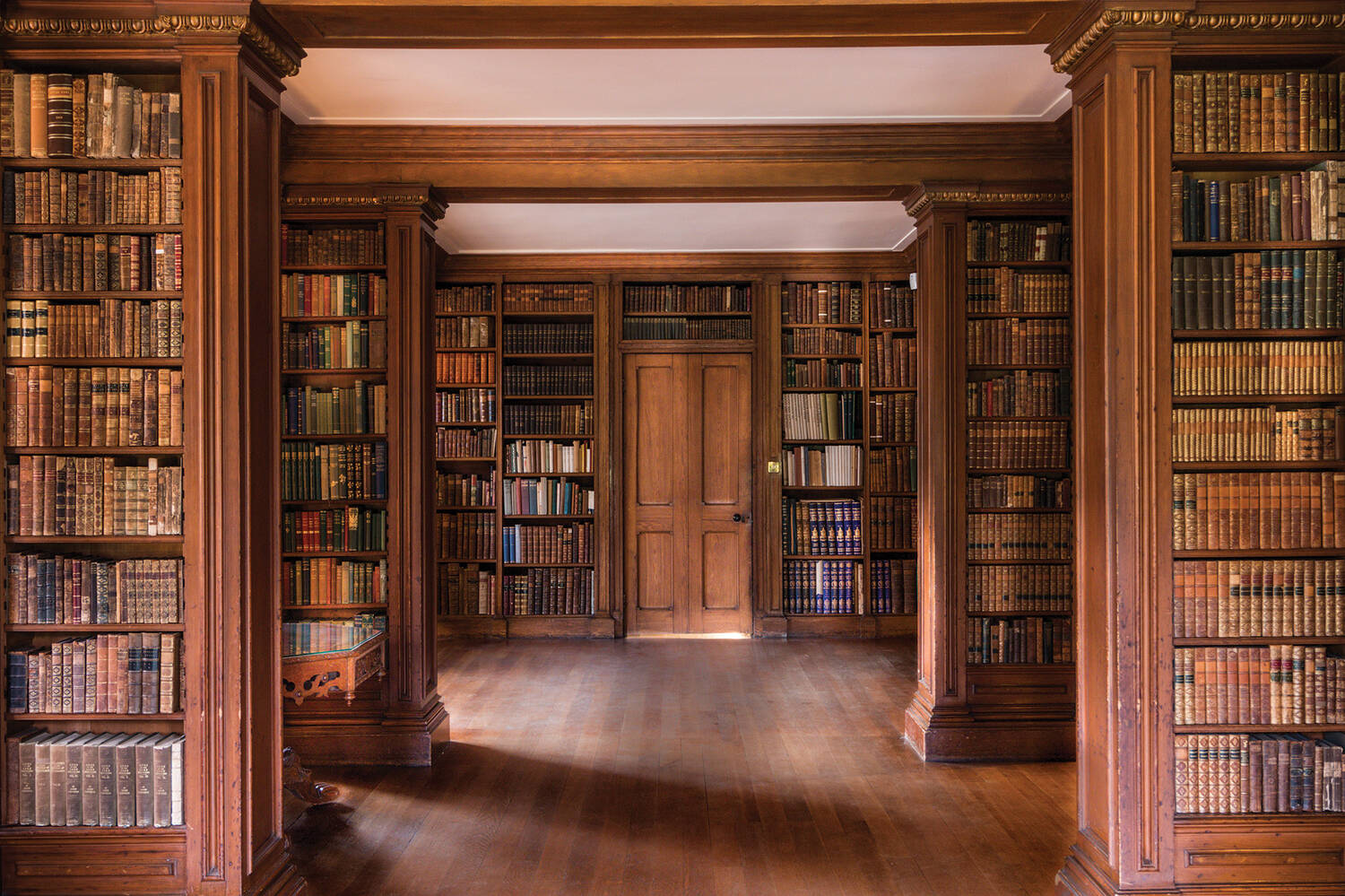 Books on shelves in Brodie Castle library