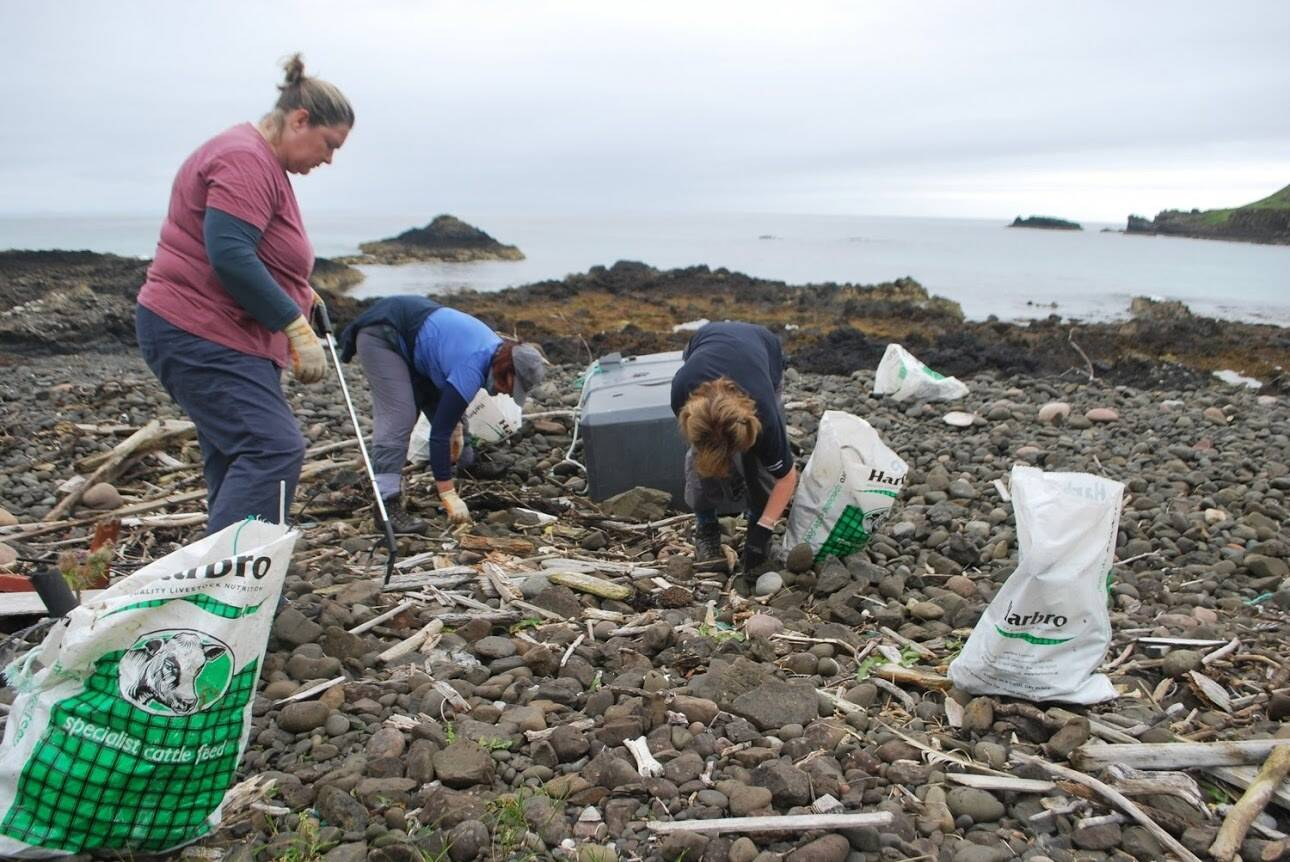 Conservation Volunteers hard at work beach clearing, along the coast of Canna.