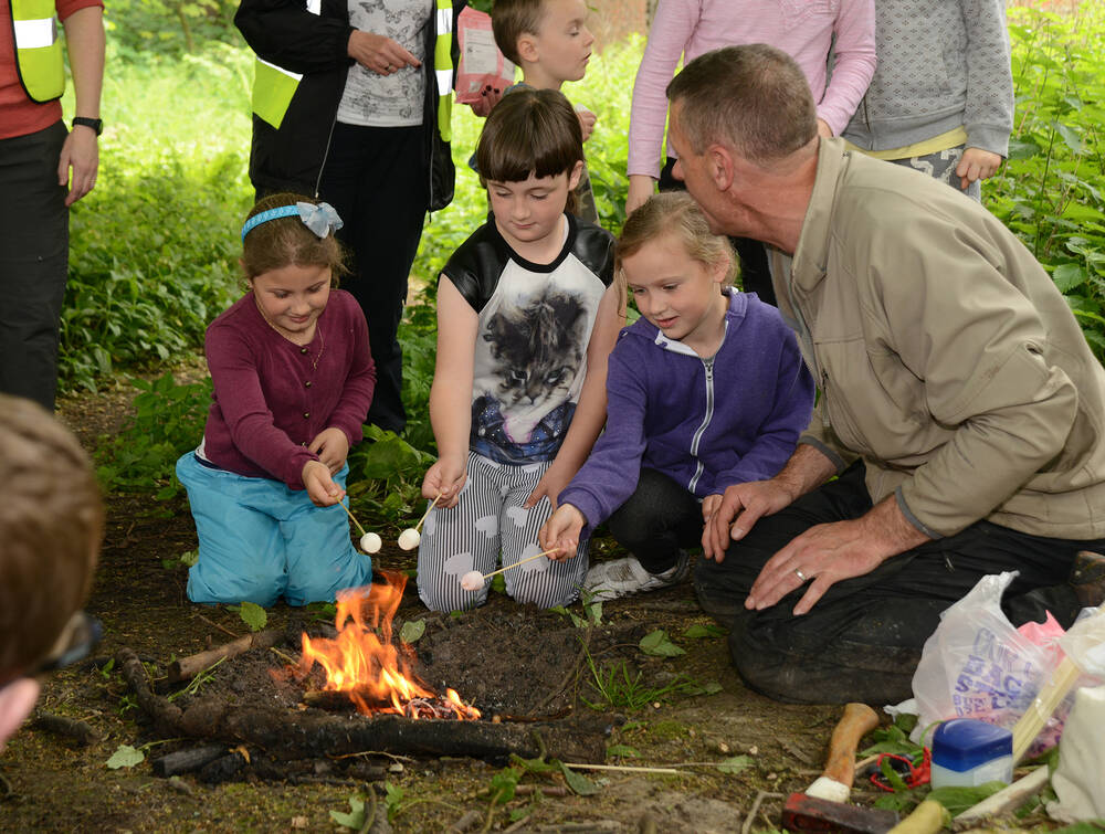 Natural Connections Play event – toasting marshmallows around a bonfire