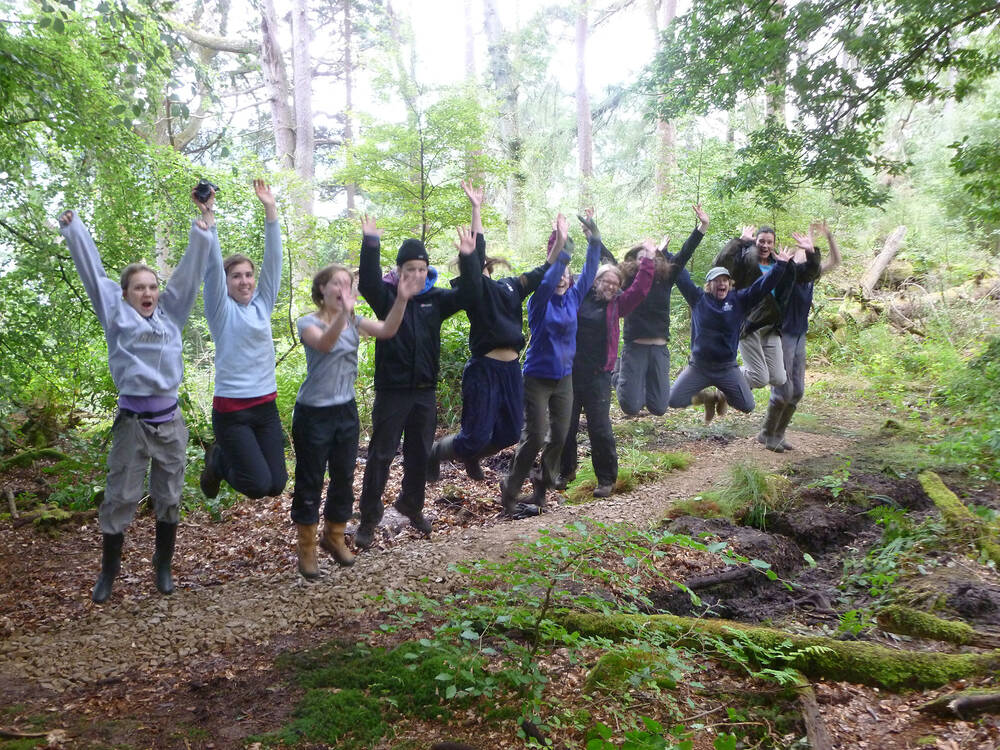 Outreach youth group jumping on their forest project