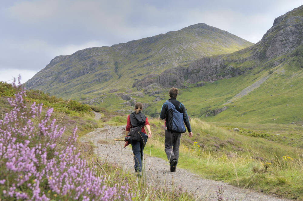 Couple walking on a path in Glencoe