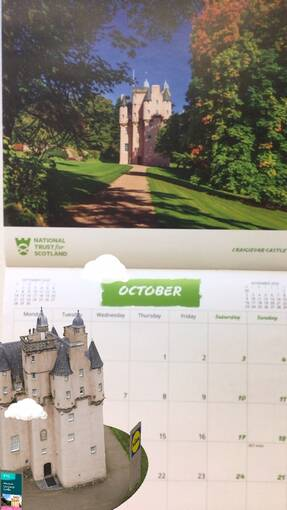 The new Craigievar Castle Instagram AR filter sits in front of a calendar showing a photo of the real Craigievar Castle