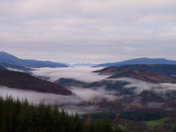 A misty view from Craigower to the west over Loch Tummel and Loch Rannoch