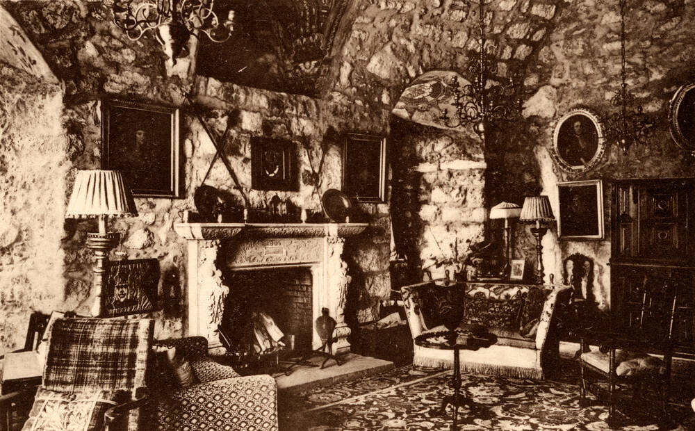 An old photograph of the High Hall in Crathes Castle, with the Horn of Leys above the fireplace