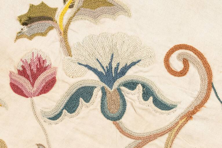 An embroidered iris found on the panel at Crathes Castle