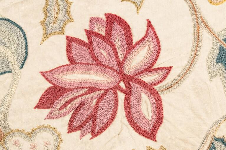 An embroidered red and pink peony, found on the panel at Crathes Castle