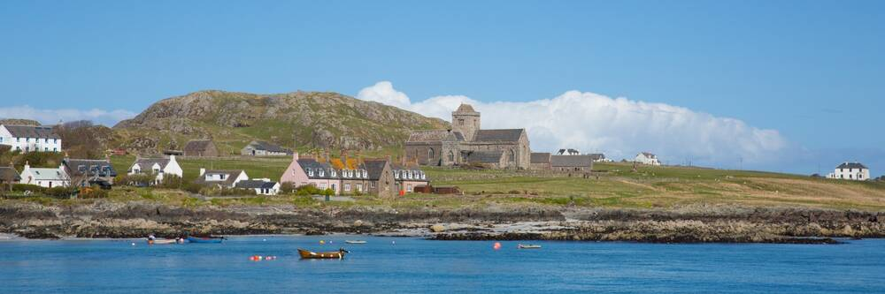 Iona viewed from the sea on a sunny day