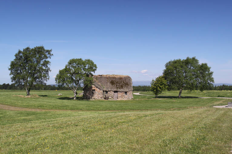 Old Leanach cottage, built on the grassy moor